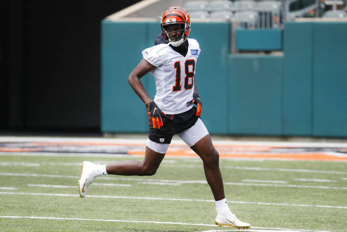 FILE - In this June 12, 2019, file photo, Cincinnati Bengals wide receiver A.J. Green participates during practice at the team's NFL football facility in Cincinnati. A.J. Green has started running for the first time since he hurt his ankle during the opening practice of training camp, an indication he's healing quickly from surgery. Green was out of his protective boot Wednesday, Sept. 11, 2019,  for the first time since the injury. The Bengals expect him back during the first half of the season, although there's no specific target for his return. (AP Photo/John Minchillo, File)