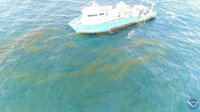 This September 2018 photo provided by NOAA shows a NOAA research vessel at a Taylor Energy production site in the Gulf of Mexico. A new federally led study of oil seeping from a platform toppled off Louisiana's coast 14½ years ago found releases lower than other recent estimates, but contradicts the well owner's assertions about the amount and source of oil. (NOAA via AP)