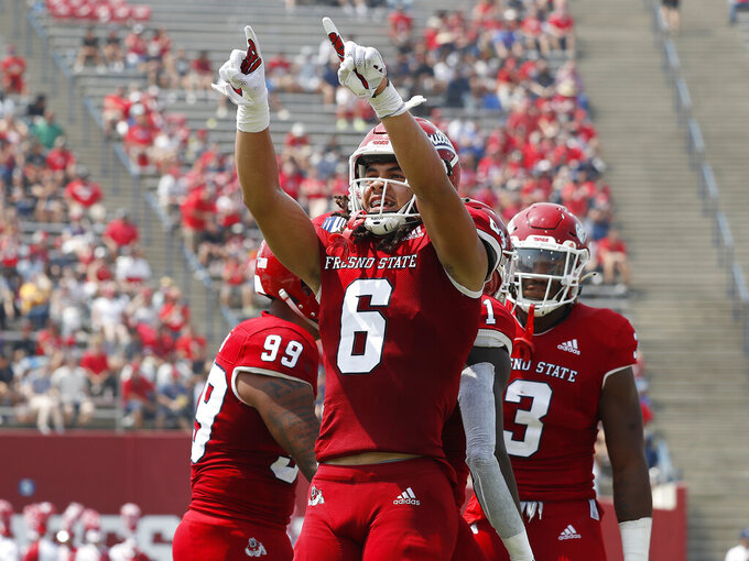Fresno State's Levelle Bailey celebrates a sack against Connecticut during the first half of an NCAA college football game in Fresno, Calif., Saturday, Aug. 28, 2021. (AP Photo/Gary Kazanjian)
