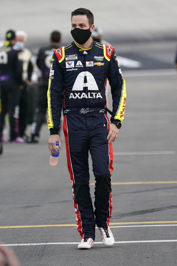 Alex Bowman walks to his car prior to the start of a NASCAR Cup Series auto race Saturday, Sept. 19, 2020, in Bristol, Tenn. (AP Photo/Steve Helber)