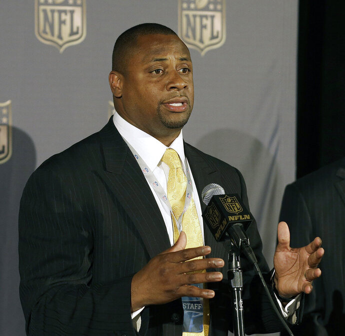 FILE - In this May 19, 2015, file photo, Troy Vincent, NFL executive vice president of football operations, speaks at the NFL's spring meetings in San Francisco. The NFL is launching a social justice platform, with an emphasis on education, economic development and community and police relations. Vincent emphasizes how much work has been done and continues to be done by the players. (AP Photo/Jeff Chiu, File)