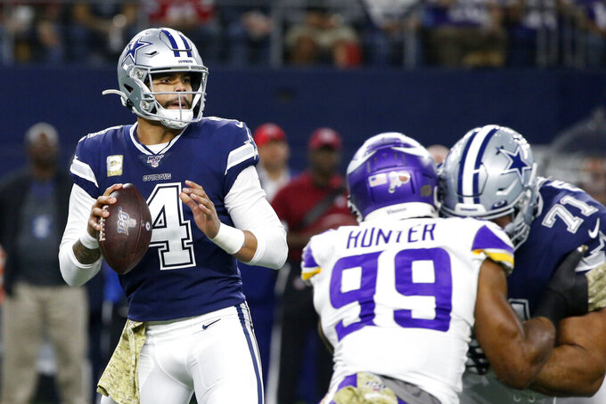 Dallas Cowboys quarterback Dak Prescott (4) prepares to throw a pass under pressure from Minnesota Vikings defensive end Danielle Hunter (99) as Cowboys offensive tackle La'el Collins (71) defends during the first half of an NFL football game in Arlington, Texas, Sunday, Nov. 10, 2019. (AP Photo/Ron Jenkins)