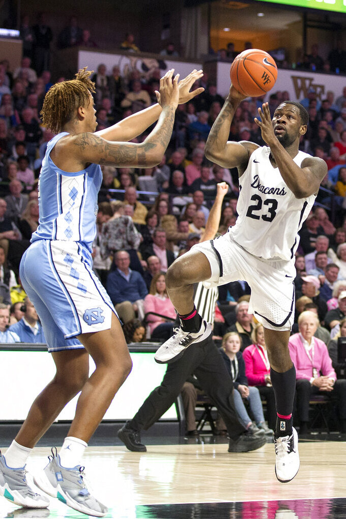 Wake Forest's guard Chaundee Brown (23) shoots over North Carolina's forward Armando Bacot (5) in the first half of an NCAA college basketball game Tuesday, Feb. 11, 2020 in Winston-Salem, N.C. (AP Photo/Lynn Hey)