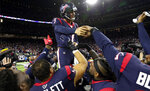 Houston Texans kicker Ka'imi Fairbairn (7) celebrates with teammates after kicking the game-winning field goal against the Buffalo Bills during overtime of an NFL wild-card playoff football game Saturday, Jan. 4, 2020, in Houston. The Texans won 22-19. (AP Photo/Michael Wyke)
