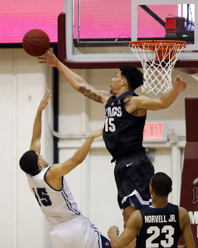 Gonzaga forward Brandon Clarke, top, blocks a shot from Loyola Marymount guard Joe Quintana (15) during the first half of an NCAA basketball game Thursday, Feb. 14, 2019, in Los Angeles. (AP Photo/Marcio Jose Sanchez)