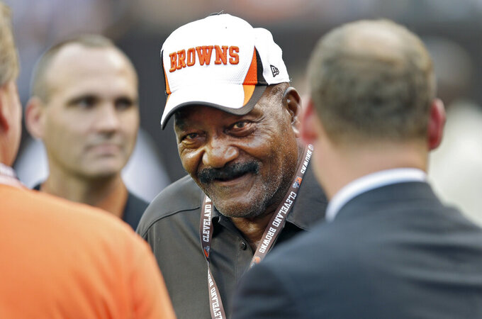 FILE - In this Thursday, Aug. 8, 2013 file photo, Hall of Fame running back Jim Brown visits on the sidelines before a preseason NFL football game between the St. Louis Rams and Cleveland Browns in Cleveland. Mention the NFL draft, and the debate begins immediately. Who's the best player ever taken at No. 1 overall or the top player ever taken in a late round? (AP Photo/Mark Duncan, File)