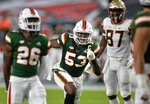 Miami linebacker Zach McCloud celebrates a play against Florida State during the first half of an NCAA college football game Saturday, Sept. 26, 2020, in Miami Gardens, Fla. (Michael Laughlin/South Florida Sun-Sentinel via AP)