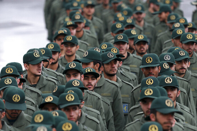 FILE - In this Feb, 11, 2019 file photo, Iranian Revolutionary Guard members arrive for a ceremony celebrating the 40th anniversary of the Islamic Revolution, at the Azadi, or Freedom, Square, in Tehran, Iran.  President Donald Trump's administration is preparing to designate Iran's Revolutionary Guard as a