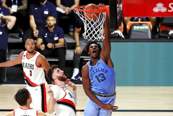 Memphis Grizzlies' Jaren Jackson Jr. dunks the ball during the second half  of an NBA basketball game against the Memphis Grizzlies against the Portland Trail Blazers, Friday, July 31, 2020, in Lake Buena Vista, Fla. (Mike Ehrmann/Pool Photo via AP)