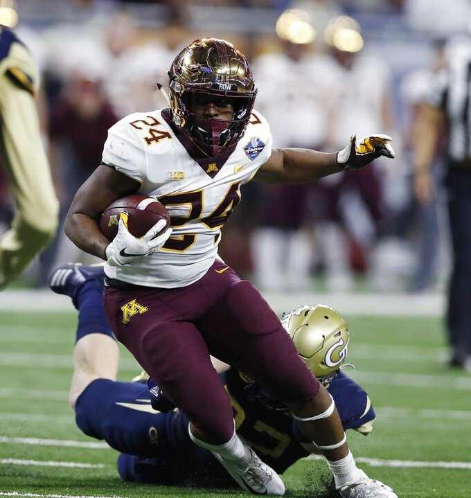 Minnesota running back Mohamed Ibrahim (24) carries during the first half of the Quick Lane Bowl NCAA college football game against Georgia Tech, Wednesday, Dec. 26, 2018, in Detroit. (AP Photo/Carlos Osorio)
