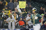 A fan holds a sign that reads