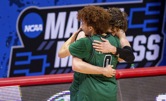 Ohio guard Jason Preston (0) and forward Ben Vander Plas (5) celebrate their defeat of Virginia in a first-round game in the NCAA men's college basketball tournament, Saturday, March 20, 2021, at Assembly Hall in Bloomington, Ind. (AP Photo/Doug McSchooler)