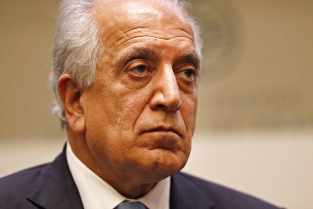 "FILE - In this Feb. 8, 2019, file photo, Special Representative for Afghanistan Reconciliation Zalmay Khalilzad pauses while speaking about the prospects for peace, at the U.S. Institute of Peace, in Washington.  Afghanistan's former deputy minister says Khalilzad is in the Afghan capital ""to discuss the latest in peace efforts.""  Former deputy foreign minister Hekmat Karzai tweeted pictures of his meeting with Khalilzad Wednesday, Dec. 4, 2019,  saying 'we spoke about the way forward.""   (AP Photo/Jacquelyn Martin, File)"
