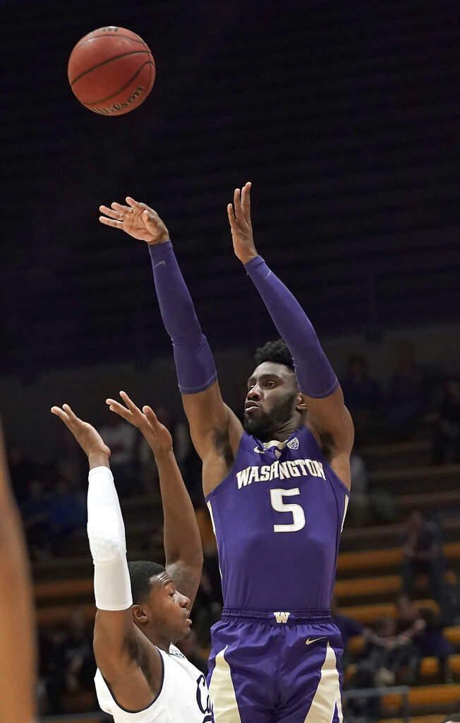 Washington guard Jaylen Nowell (5) takes a 3-point shot over California guard Darius McNeill during the first half of an NCAA college basketball game Thursday, Feb. 28, 2019, in Berkeley, Calif. (AP Photo/Tony Avelar)