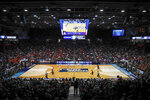 Spectators watch from the stands during the first half of a First Four game of the NCAA college basketball tournament between Temple and Belmont, Tuesday, March 19, 2019, in Dayton, Ohio. (AP Photo/John Minchillo)
