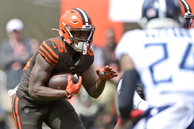 Cleveland Browns running back Dontrell Hilliard rushes for a 4-yard touchdown during the first half in an NFL football game against the Tennessee Titans, Sunday, Sept. 8, 2019, in Cleveland. (AP Photo/David Richard)