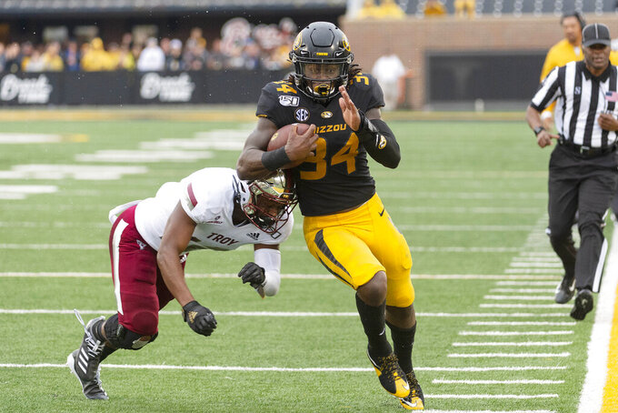 Missouri running back Larry Rountree III, right, is tackled just short of the goal line by Troy's Melvin Tyus, left, during the first half of an NCAA college football game Saturday, Oct. 5, 2019, in Columbia, Mo. (AP Photo/L.G. Patterson)
