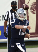 Nevada quarterback Carson Strong throws a pass against Utah State during the first half of an NCAA college football game Thursday, Nov. 5, 2020, in Reno, Nev. (AP Photo/Lance Iversen)