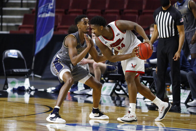 Eastern Washington guard Kim Aiken Jr. (24) defends the ball from Montana State forward Abdul Mohamed during an NCAA college basketball game for the championship of the Big Sky men's tournament in Boise, Idaho, Saturday, March 13, 2021. Eastern Washington won 65-55. (AP Photo/Otto Kitsinger)