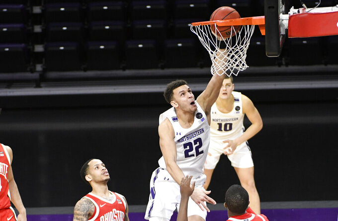 Northwestern forward Pete Nance (22) dunks the ball against Ohio State during the second half of an NCAA college basketball game, Saturday, Dec. 26, 2020, in Evanston, Ill. (AP Photo/David Banks)