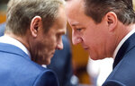 FILE - In this June 26, 2015 file photo, European Council President Donald Tusk, left, speaks with British Prime Minister David Cameron during a summit of EU leaders in Brussels at which Cameron sought some changes in Britain's terms of membership of the bloc. They didn't prove to be enough as Britain voted in June of that year to leave the EU. It is finally scheduled to actually leave on Jan. 31, 2020 after 47 years of membership. (AP Photo/Geert Vanden Wijngaert, File)