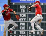 Los Angeles Angels' Andrelton Simmons, left, and Kole Calhoun celebrate the team's win over the Houston Astros in a baseball game, Saturday, Sept. 21, 2019, in Houston. (AP Photo/Eric Christian Smith)