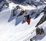 This Monday, May 20, 2019 photo provided by Miles Clark shows him doing a backflip on a run at Squaw Valley Ski Resort, Calif., after a late spring storm blanketed the area with snow. Much of the West is experiencing weird weather. Large swaths of California have seen two to five times more precipitation than is normal for this point in May, the National Weather Service said. (Aaron Fox/Miles Clark via AP)