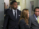 Cuba Gooding Jr., left, follows his legal team from court after he pleaded not guilty to sexual misconduct charges, Tuesday Oct. 15, 2019, in New York. The new charge involves an alleged incident in October 2018. The defense paints it as a shakedown attempt. (AP Photo/Bebeto Matthews)