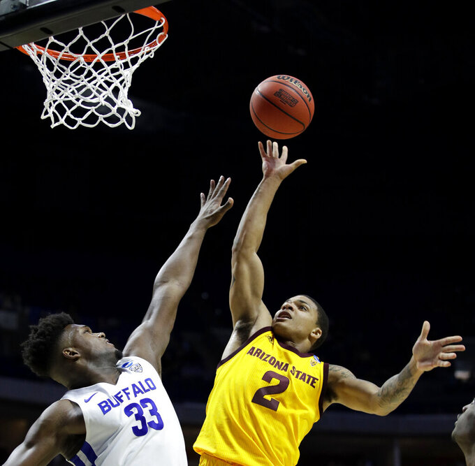 Arizona State's Rob Edwards (2) shoots over Buffalo's Nick Perkins (33) during the first half of a first round men's college basketball game in the NCAA Tournament Friday, March 22, 2019, in Tulsa, Okla. (AP Photo/Charlie Riedel)