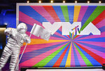 """FILE - A statue of the MTV Moon Man appears on the red carpet at the MTV Video Music Awards at Radio City Music Hall on Monday, Aug. 20, 2018, in New York. Lady Gaga and Ariana Grande both scored nine VMA nominations each, including video of the year for their No. 1 dance hit. """"Rain on Me"""" is also competing for song of the year, best collaboration, best pop, best cinematography, best visual effects and best choreography. The 2020 MTV Video Music Awards will air live on Aug. 30 from the Barclays Center in Brooklyn. (Photo by Charles Sykes/Invision/AP, File)"""