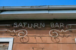 The Saturn Bar name is traced in neon tubes outside the Ninth Ward bar, which got its start in 1960 and grew into a low-key New Orleans institution. (Ian McNulty/The Times-Picayune/The New Orleans Advocate via AP)