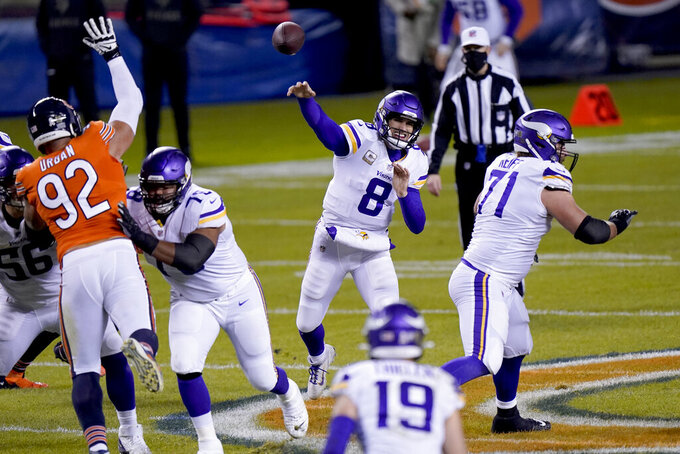 Minnesota Vikings quarterback Kirk Cousins (8) throws during the first half of an NFL football game against the Chicago Bears Monday, Nov. 16, 2020, in Chicago. (AP Photo/Nam Y. Huh)