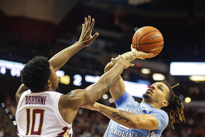 North Carolina guard Cole Anthony (2) tries to shoot over Florida State forward Malik Osborne (10) in the first half of an NCAA college basketball game in Tallahassee, Fla., Monday, Feb. 3, 2020. (AP Photo/Mark Wallheiser)