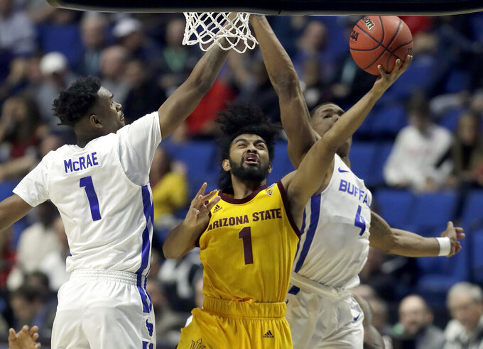 Arizona State's Remy Martin, center, heads to the basket past Buffalo's Montell McRae and Davonta Jordan, right, during the first half of a first round men's college basketball game in the NCAA Tournament Friday, March 22, 2019, in Tulsa, Okla. (AP Photo/Jeff Roberson)