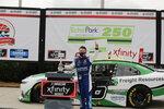 AJ Allmendinger celebrates after he won a NASCAR Xfinity Series auto race at Atlanta Motor Speedway, Saturday, June 6, 2020, in Hampton, Ga. (AP Photo/Brynn Anderson)