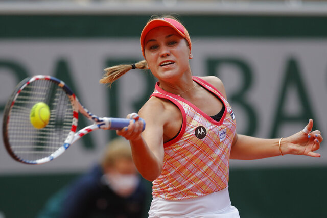 File - In this Oct. 10, 2020, file photo, Sofia Kenin, of the United States, plays a shot against Poland's Iga Swiatek in the final match of the French Open tennis tournament at the Roland Garros stadium in Paris, France. Kenin is the top-seeded woman in Abu Dhabi, where the first women's tour-level tennis event of 2021 begins main-draw play on Wednesday, Jan. 6, 2021. (AP Photo/Michel Euler, File)