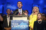 FILE - In this Nov. 5, 2019, file photo, Kentucky Attorney General and Democratic gubernatorial candidate Andy Beshear stands with his wife, Britainy as he delivers a speech at the Kentucky Democratic Party election night watch party in Louisville, Ky. A re-election victory by Louisiana Gov. John Bel Edwards has assured Democrats a place at the table when political maps are redrawn after the 2020 census. Edwards' narrow triumph on Saturday, Nov. 16 marked the third significant win in a Southern state in two weeks for Democrats, following their takeover of the Virginia General Assembly and the defeat of Republican Kentucky Gov. Matt Bevin by Beshear.   (AP Photo/Bryan Woolston, File)