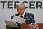 Mexican President Andrés Manuel López Obrador looks at a document as he delivers his first year's state of the nation address at the National Palace in Mexico City, Sunday, Sept. 1, 2019. (AP Photo/Marco Ugarte)