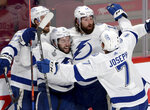 Tampa Bay Lightning's Pat Maroon (14) celebrates his goal with teammates Ryan McDonagh (27), Tyler Johnson (9) and Mathieu Joseph (7) during the third period of Game 4 of the NHL hockey Stanley Cup final against the Montreal Canadiens in Montreal, Monday, July 5, 2021. (Ryan Remiorz/The Canadian Press via AP)
