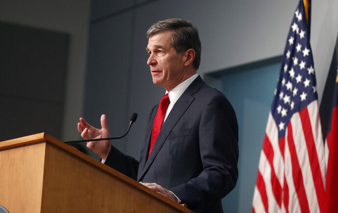 North Carolina Gov. Roy Cooper speaks during a briefing at the Emergency Operations Center in Raleigh, N.C., Tuesday, June 2, 2020. (Ethan Hyman/The News & Observer via AP)