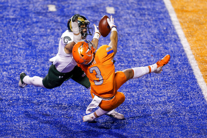 Boise State tight end Riley Smith (3) reaches for a pass, which was broken up by Colorado State defensive back Henry Blackburn during the first half of an NCAA college football game Thursday, Nov. 12, 2020, in Boise, Idaho. (AP Photo/Steve Conner)