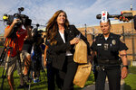 Former Pennsylvania Attorney General Kathleen Kane departs from the Montgomery County Correctional Facility in Eagleville, Pa., on Wednesday, July 31, 2019. Kane was sentenced in 2016 to 10-to-23 months for perjury, obstruction and other counts. (Christopher Dolan/The Times-Tribune via AP)