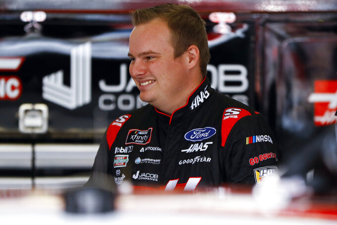 Cole Custer smiles in his garage stall before a practice session for Saturday's NASCAR Xfinity Series auto race at Pocono Raceway, Friday, May 31, 2019, in Long Pond, Pa. (AP Photo/Matt Slocum)