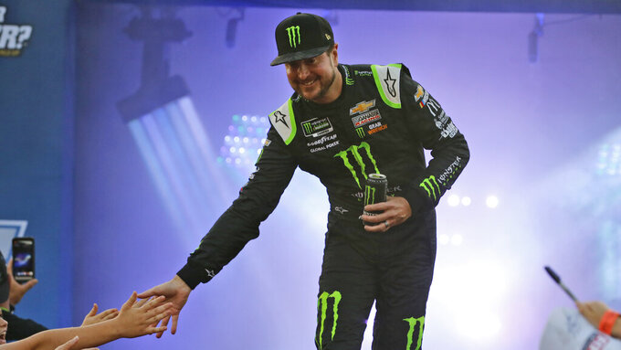 Kurt Busch greets fans during driver introductions for the NASCAR Monster Energy Cup series auto race at Richmond Raceway in Richmond, Va., Saturday, Sept. 21, 2019. (AP Photo/Steve Helber)