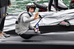 FILE - In this March 10, 2021 file photo Italy's Luna Rossa helmsman Jimmy Spithill waves as he prepares to race Team New Zealand in race one of the America's Cup on Auckland's Waitemata Harbour. Three weeks after his Italian-based team lost the America's Cup match, Spithill is pivoting to SailGP and his role as CEO and helmsman of the reconfigured American team, which looks to bounce back from a last-place finish in the global league's inaugural season. (Alan Lee/Photosport via AP,File)