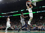 Boston Celtics' Gordon Hayward dunks as Indiana Pacers' Darren Collison looks on during the second quarter of an NBA basketball game Friday, March 29, 2019, in Boston. (AP Photo/Winslow Townson)
