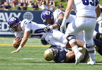 Navy's Diego Fagot stops the Holy Cross quarterback Connor Degenhardt from picking up a first down in the first quarter of an NCAA college football game, Saturday, Aug. 31, 2019, in Annapolis, Md. (Paul W. Gillespie/Capital Gazette via AP)