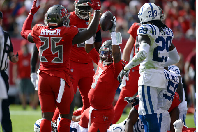 Tampa Bay Buccaneers quarterback Jameis Winston (3) celebrates his 1-yard touchdown run with running back Peyton Barber (25) during the first half of an NFL football game against the Indianapolis Colts Sunday, Dec. 8, 2019, in Tampa, Fla. (AP Photo/Jason Behnken)