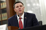 University of Mississippi Vice Chancellor for Intercollegiate Athletics Keith Carter testifies before a Senate Commerce Committee hearing on Capitol Hill in Washington, Wednesday, July 1, 2020. The hearing is looking at the National Collegiate Athletic Association Board of Governors' recent report on student-athlete compensation and the modernization of rules related to name, image, and likeness commercialization. (AP Photo/Susan Walsh)