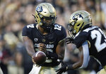 Colorado quarterback Brendon Lewis, left, hands off the ball to running back Jarek Broussard in the first half of an NCAA college football game against Northern Colorado, Friday, Sept. 3, 2021, in Boulder, Colo. (AP Photo/David Zalubowski)